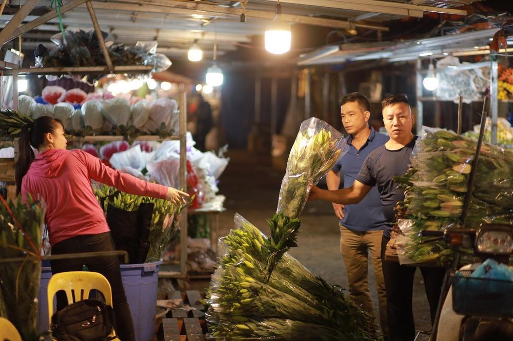 Chùm ảnh: Những con người không ngủ đón đông cùng Hà Nội Ảnh 5