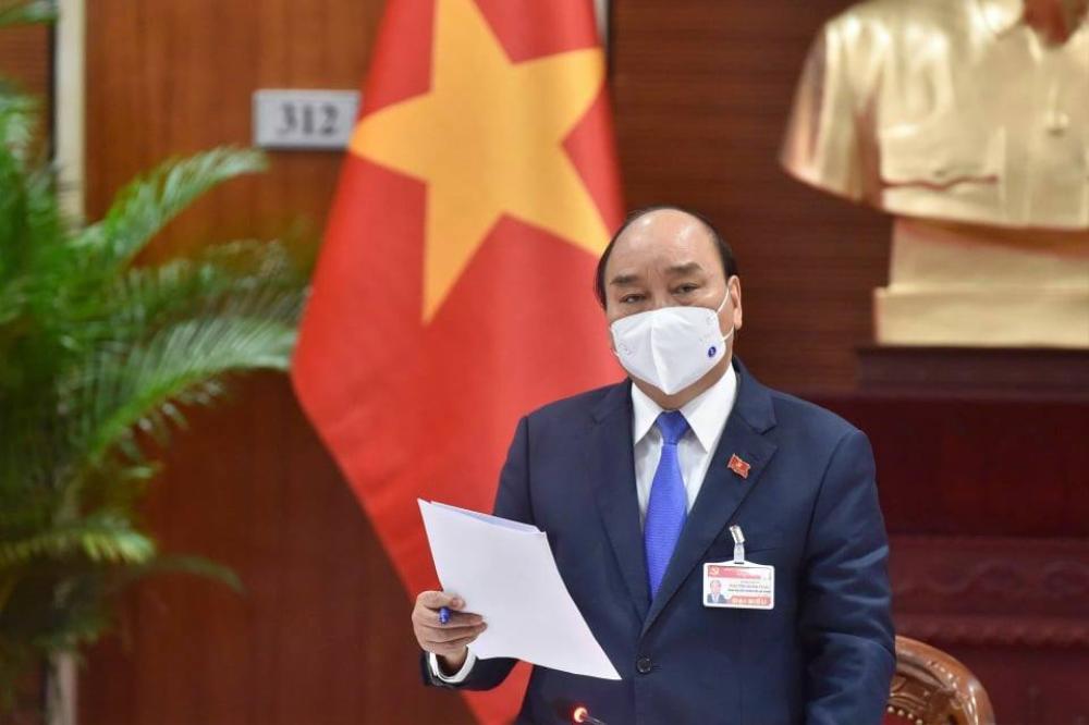 Thủ tướng triệu tập cuộc họp khẩn phòng chống COVID-19 ngay tại phòng họp Đại hội Đảng XIII Ảnh 1