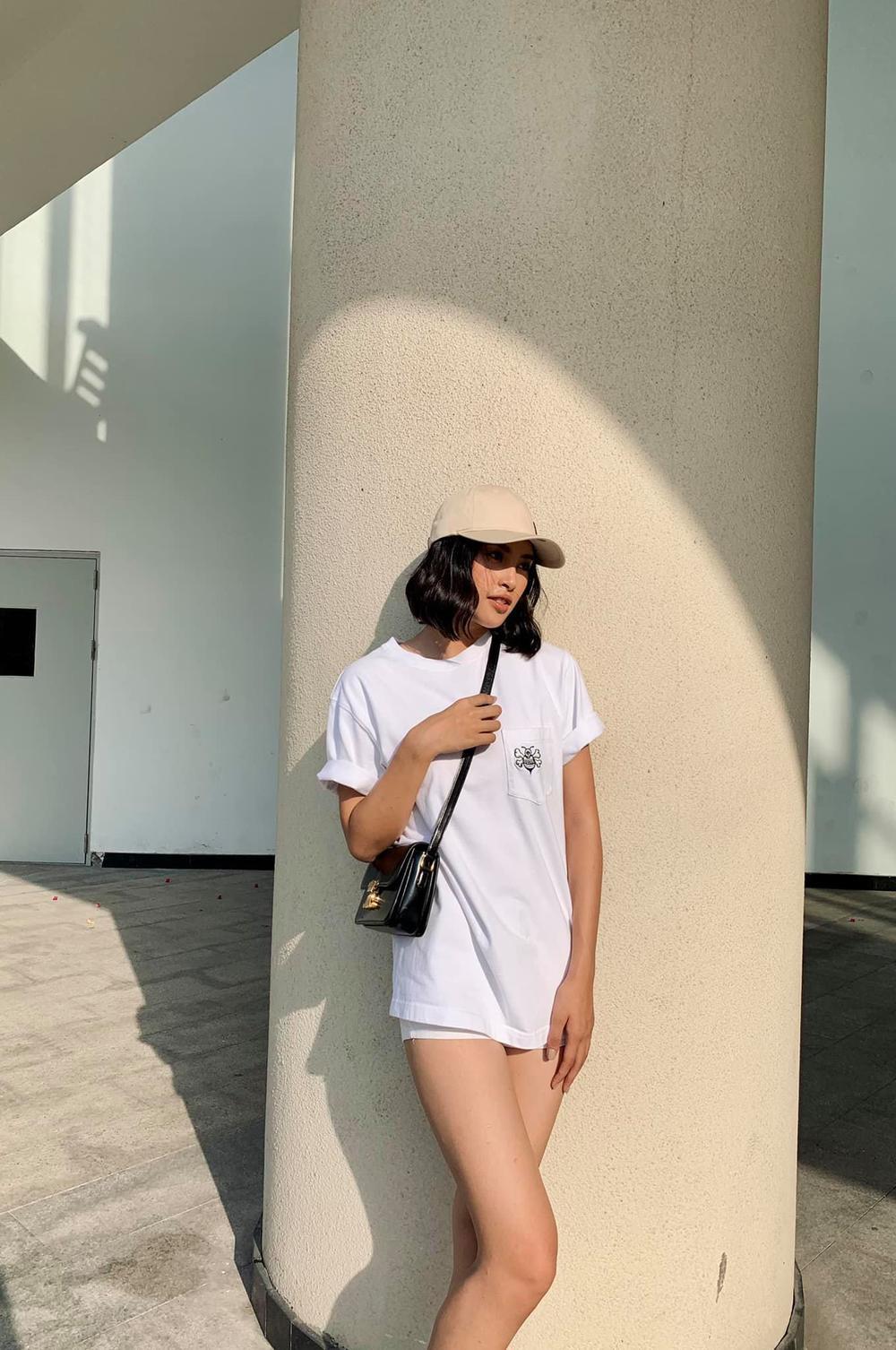 Hoa hậu Tiểu Vy cool ngầu xuống phố với set đồ tomboy lạ mắt Ảnh 6