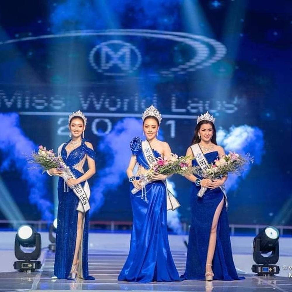 Tân hoa hậu Lào bỏ ngôi vị vì khai gian tuổi, á hậu 1 lên ngôi 'kèn cựa' Đỗ Thị Hà tại Miss World? Ảnh 1