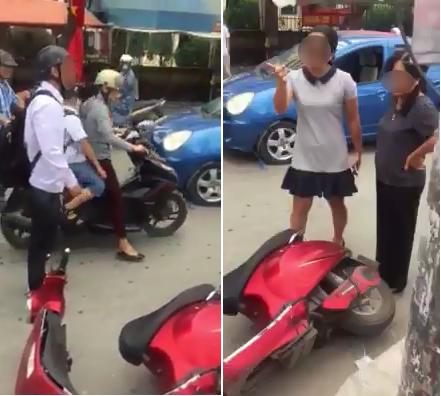 Vụ va chạm diễn ra giữa nam sinh áo trắng đi xe máy điện màu đỏ và 2 người phụ nữ đi xe con màu xanh. Ảnh cắt từ clip.