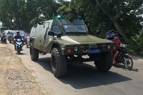 Người dân ở bên trong các ấp nhỏ khi đi qua tuyến đường chính ở xã Trung An đều bị kiểm tra nghiêm ngặt. Ảnh: báo Pháp Luật TP.HCM