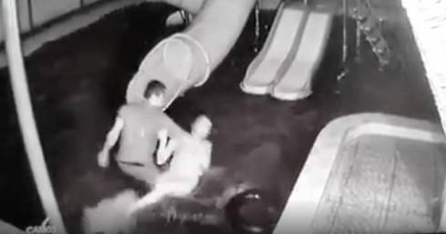 Linh đánh vợ trước mặt con nhỏ mặc cho con gào khóc thảm thiết.