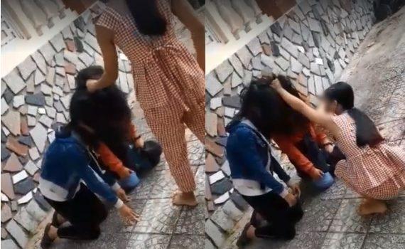 Hình ảnh nữ sinh bị bạn bắt quỳ gối, đánh đập. Ảnh: báo Kiến Thức