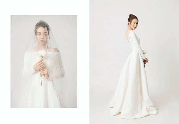 Xu hướng váy cưới trơn, không đính kết thời gian này được rất nhiều sao Việt mê mẩn vì sự tao nhã, thanh lịch của nó khi chụp ảnh cưới, đơn cử như Đàm Thu Trang.
