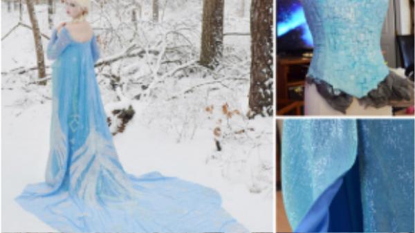 Elsa trong Nữ hoàng giá băng chẳng thua kém ai khi diện hẳn một chiếc váy dạ hội đuôi cá màu xanh thanh bình thướt tha.