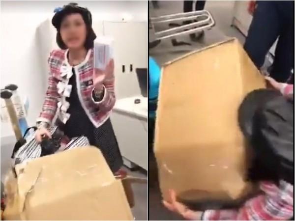 Hình ảnh chị D. bị nhân viên sân bay yêu cầu mở thùng hàng để kiểm tra.