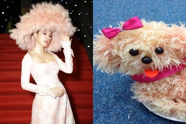 Phương Trinh cũng không nằm ngoài cuộc khi được ví như chú cún làm bằng quả bưởi cực vui nhộn, mặc cho việc chiếc mũ của cô nàng vẫn đang còn trong nghi án đạo nhái ý tưởng từ nhà mốt Valentino.