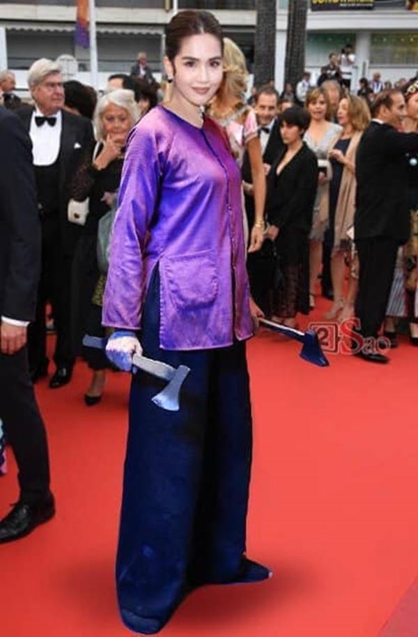 Hay quyết định lựa ngay bộ đồ bà ba màu tím của Hai Phượng. (Nguồn: Internet)