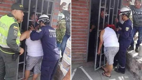 Người phụ nữ kẹt đầu vào song sắt khi thò đầu vào bên trong cửa.