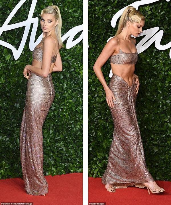 Chân dài nhà Victoria's Secret diện bộ váy hai mảnh sequin lấp lánh, để lộ vòng một căng tràn và vòng eo sát rạt. Mái tóc đuôi ngựa được tạo kiểu cổ điển cùng tông makeup nâu trầm , mắt khói