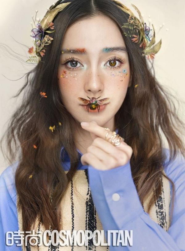 Vợ của Huỳnh Hiểu Minh đẹp mơ màng với tông makeup đậm sắc màu cùng điểm nhấn gắn côn trùng trên mặt gây ấn tượng người xem