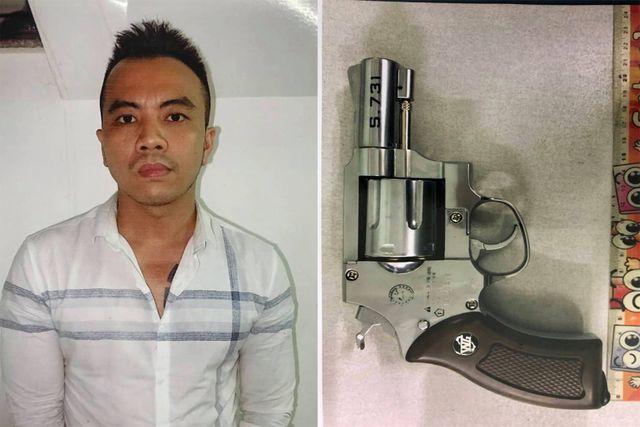 Nguyễn Văn Rin và khẩu súng mà đối tượng này dùng để cướp ngân hàng. Ảnh: Dân Trí.