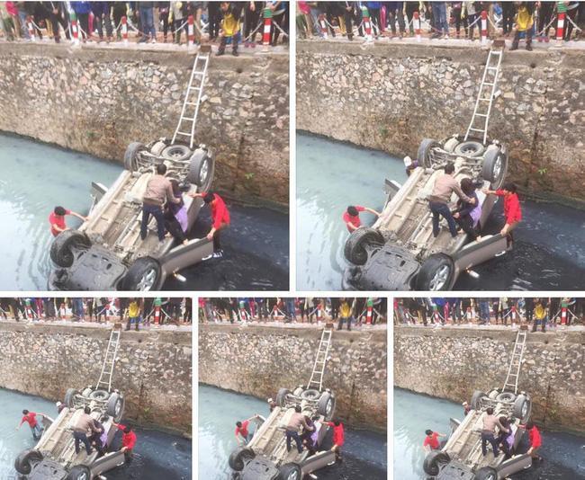Người dân nhanh chóng cứu giúp hai mẹ con ở trong xe. Ảnh: Su Bin.