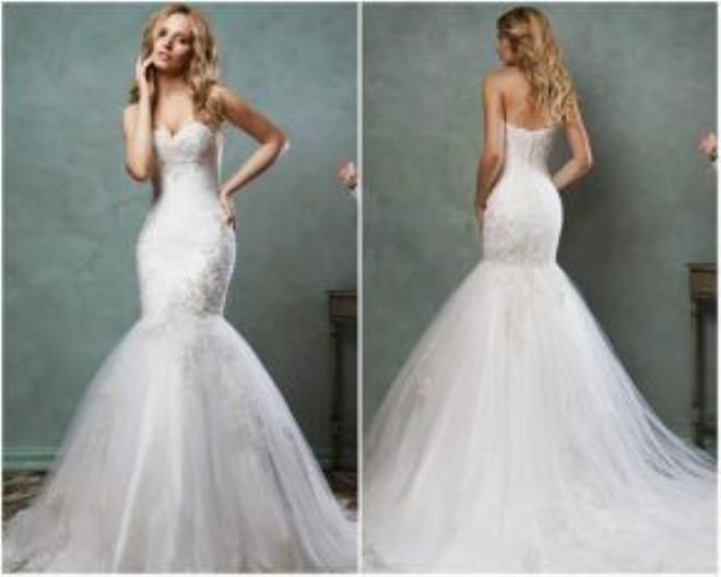 Một tay đặt trên hông và tay còn lai để hờ hững trên khuôn mặt cũng giúp cho các bạn nữ tự tin hơn khi tạo dáng với trang phục váy cưới.