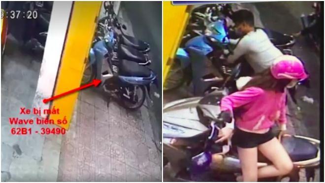 Trong khi cô gái vẫn ngồi trên xe để khuất tầm nhìn của bảo vệ, che chắn cho đồng bọn phá khoá xe máy ở sau lưng.Ảnh chụp từ clip