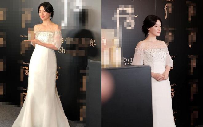 Thay bộ váy đỏ là chiếc váy trắng nữ tính , kiêu sa. Phải nói ở độ tuổi gần 50 mà thân hình của cô nuột nà còn hơn cả đàn em