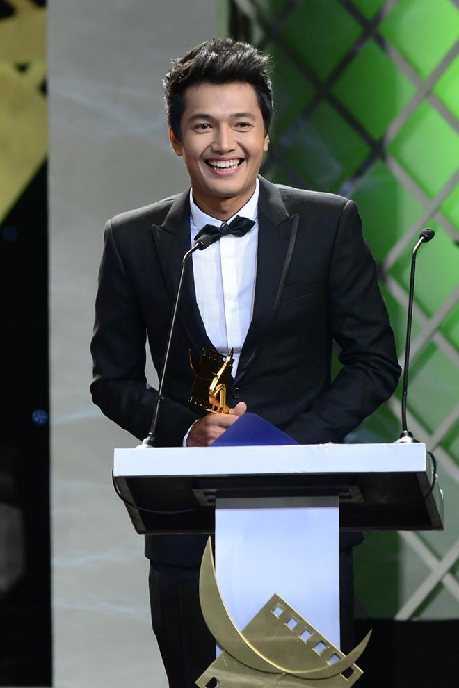 Quang Tuấn nhận giải Cánh diều vàng vào năm 2013.