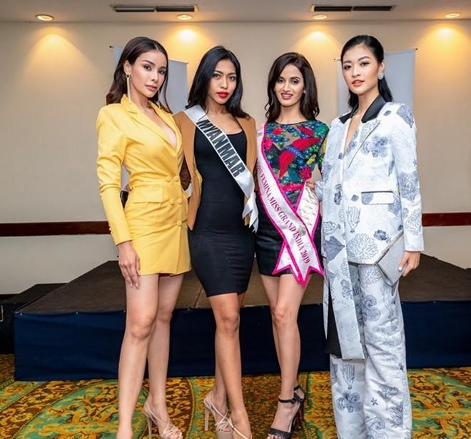 Á hậu Kiều Loan cá tính khi diện suit bên dàn thí sinh Miss Grand International.