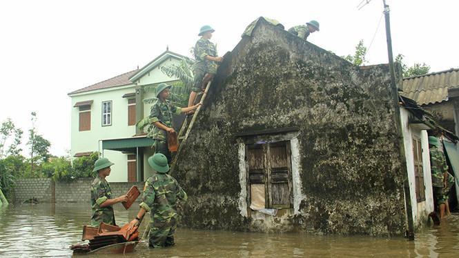 Công tác khắc phục hậu quả thiên tai đang được khẩn trương tiến hành tại Yên Bái. (Ảnh: Thanh Niên).