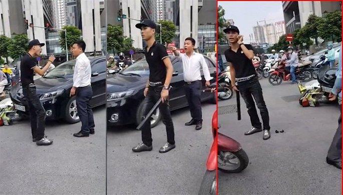 Nam thanh niên cầm điếu cày đánh tài xế ô tô sau va chạm. Ảnh cắt từ clip.