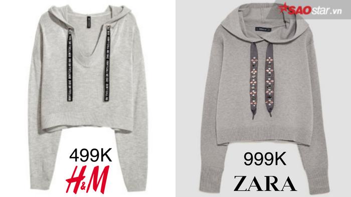 """Sắc xám ghi nhẹ nhàng, thanh lịch là lựa chọn hoàn hảo cho những cô nàng yêu thích sự trẻ trung, năng động và một chút cá tính. Đến với hai items """"đắt giá"""" có vẻ ngoài hao hao nhau này, khó có thể nói ai nhỉnh hơn ai. Nếu phần cổ khoét sâu giúp H&M ghi điểm tuyệt đối thì dải dây buộc bắt mắt của Zara khiến không ít các tín đồ thời trang """"rung rinh"""". Không nằm ngoài tầm dự đoán, hoodie nhà Zara chạm ngưỡng 999.000VNĐ và gấp đôi thiết kế H&M (499.000VNĐ)"""