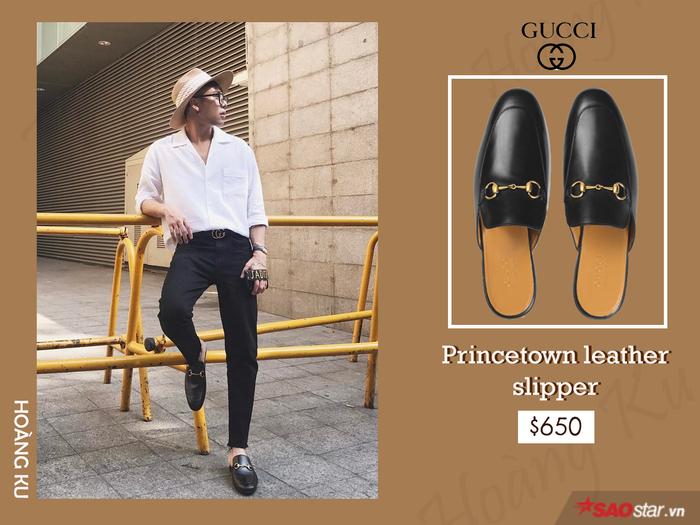 Thể hiện độ chịu chơi khi xuất hiện với quần áo đắt tiền đến từ các thương hiệu nổi tiếng chưa đủ, Hoàng Ku còn khiến giới mộ điệu ngẩn ngơ trước gia tài giày khủng. Đơn cử là đôi Princetown leather loafer đơn giản mà tốn bộn tiền.
