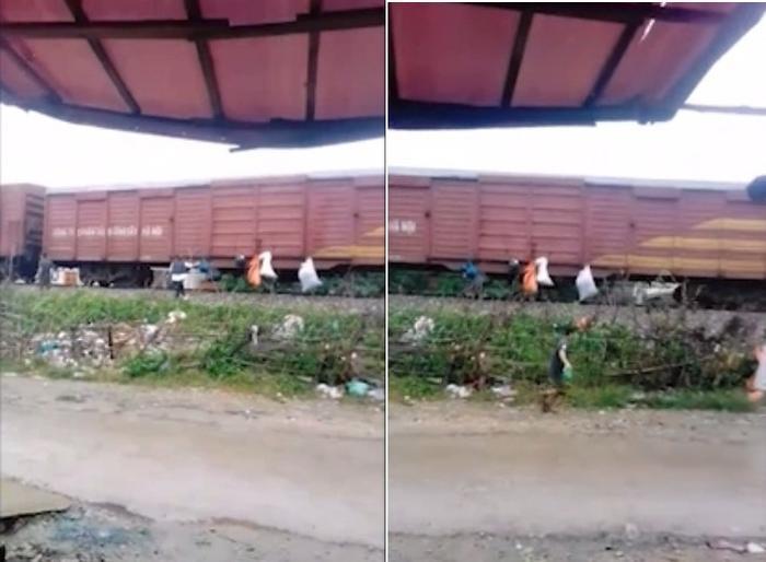 Người dân treo rác lên tàu (ảnh chụp clip)