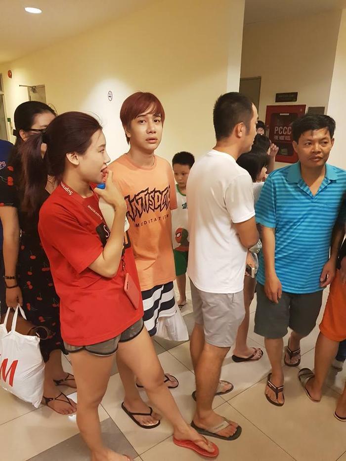 Lou Hoàng với vẻ mặt hốt hoảng khi chung cư đột nhiên bị cháy.