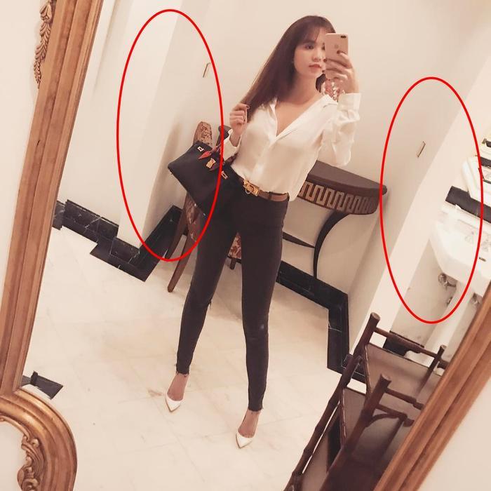 Ngọc Trinh cùng tấm ảnh khoe chân dài, eo thon nhưng độ cong bất thường của bức tường có lẽ mới chính là điều gây chú ý nhiều nhất.