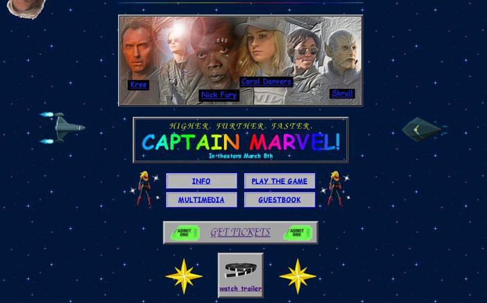Website của Captian Marvel có tất cả những gì là đặc trưng của phong cách thiết kế web những năm 90: những kí tự nhấp nháy, ảnh động độ phân giải thấp, font chức màu xanh dương đậm kích thước lớn và các nút tương tác màu xám.
