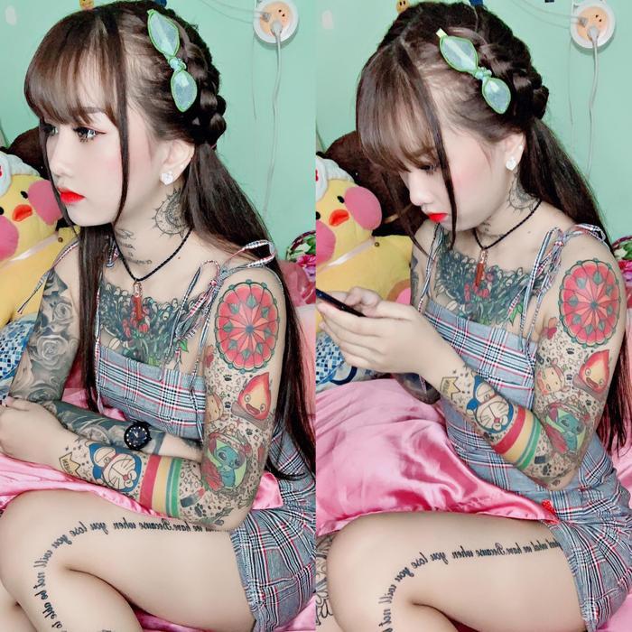 Thiên Hương với những hình xăm đầy màu sắc trên cơ thể.