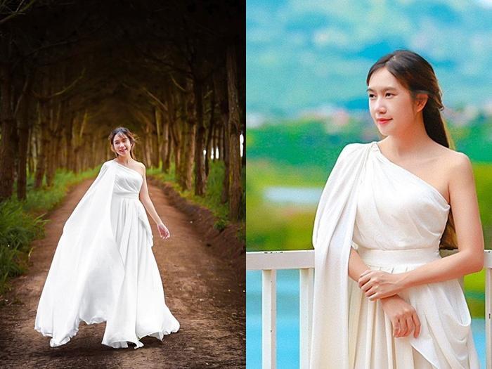 Minh Hà đẹp như nữ thần với đầm trắng lệch vai