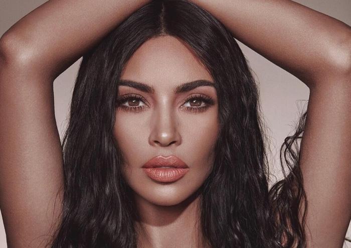 Kim Kardashian lên tiếng phủ nhận màn hợp tác của chồng với Justin Bieber.