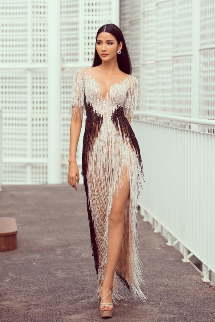 Hoàng Thùy phơi da nâu chuẩn Miss Universe, lần đầu khoe nụ cười sau khi niềng răng cấp tốc ảnh 4