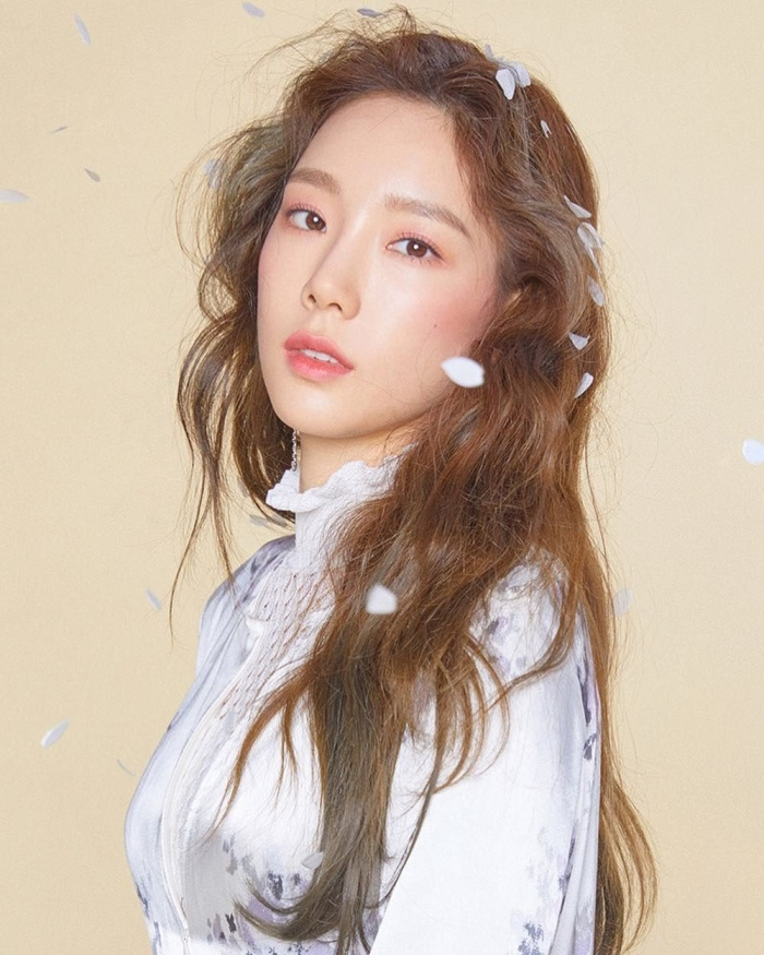 """Vị trí trưởng nhóm và hát chính chắc chắn thuộc về """"chị đại"""" Taeyeon."""