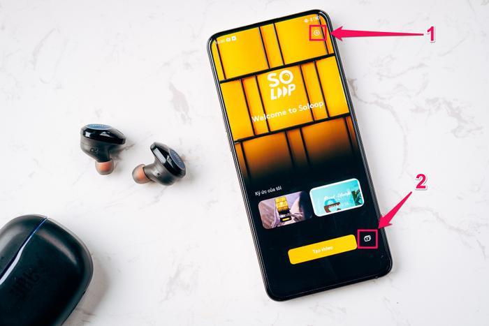 Giao diện của Soloop trên Reno2: (1) cài đặt của ứng dụng, mặc định video xuất ra chuẩn 1080p đảm bảo nét khi đăng Youtube, Tit Tok hay Facebook, (2) phần thư viện quản lý các video đang làm dở hay đã xong.