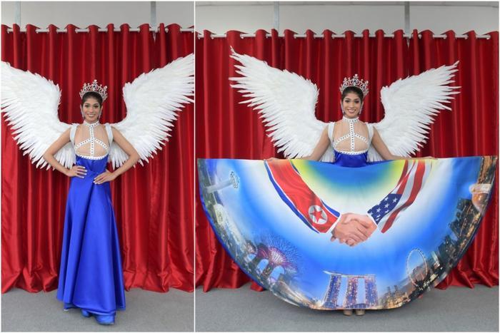 Hoa hậu Hoàn vũ Singapore 2018 vấp phảiphản ứng dữ dội trên mạng với chiếc váy lấy cảm hứng từ hội nghị thượng đỉnh Trump – Kim. Ngoài ra còn tạo diểm nhấn bằng cánh chim trắng với mong ước mang lại sự tự do, hòa bình.