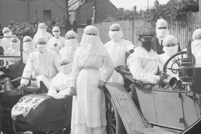 Bang New South Wales áp dụng chính sách kiểm dịch và bắt buộc đeo khẩu trang để phòng dịch cúm.