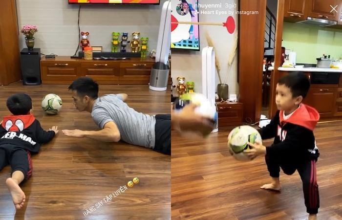 Văn Quyết dạy con trai Văn Quân tập luyện cùng trái bóng.