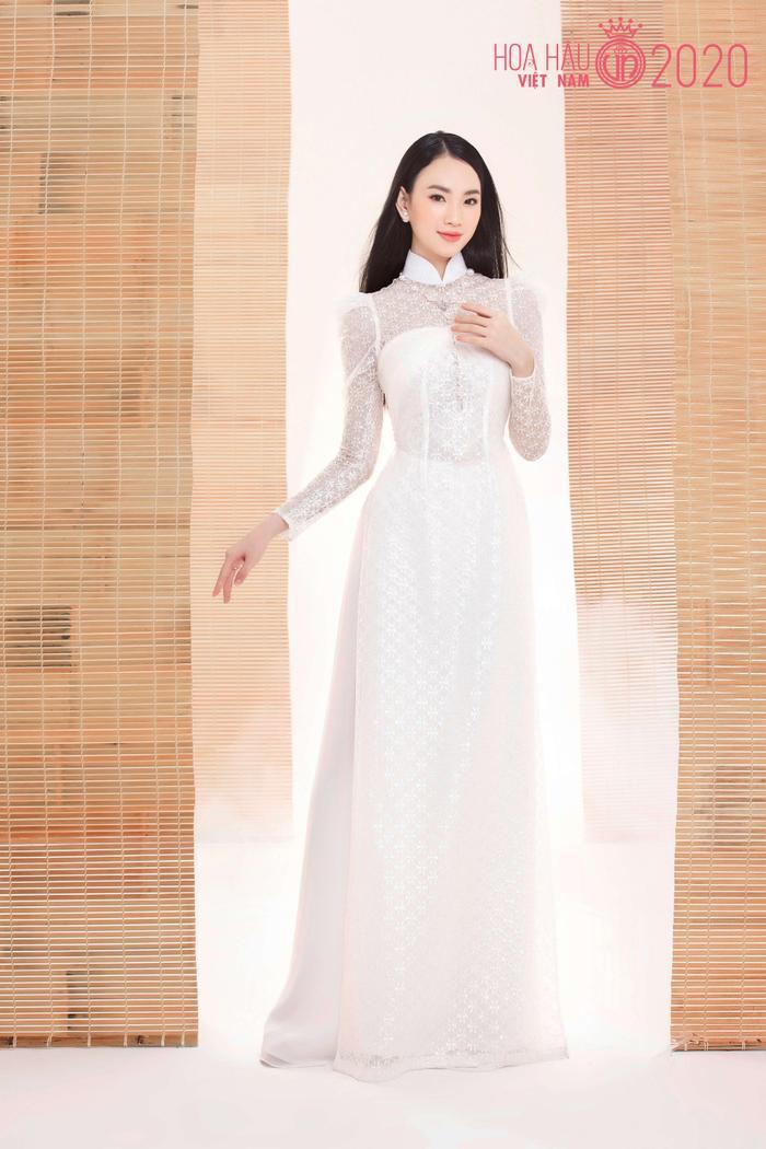 Mê mẩn ngắm nhan sắc Top 60 Hoa hậu Việt Nam 2020 diện áo dài trắng tinh khôi Ảnh 16