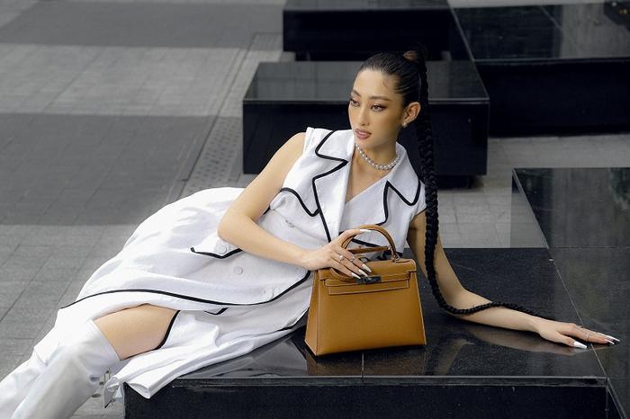 Hoa hậu Lương Thùy Linh khoe eo thon, ngực đầy trong loạt trang phục trắng tinh khiết Ảnh 7